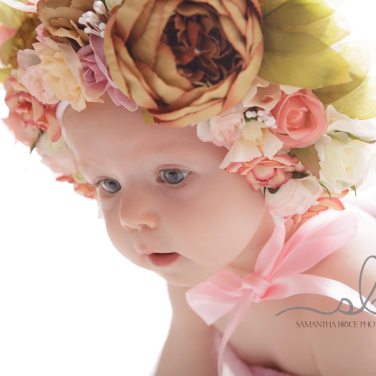 close up baby girl flower bonnet