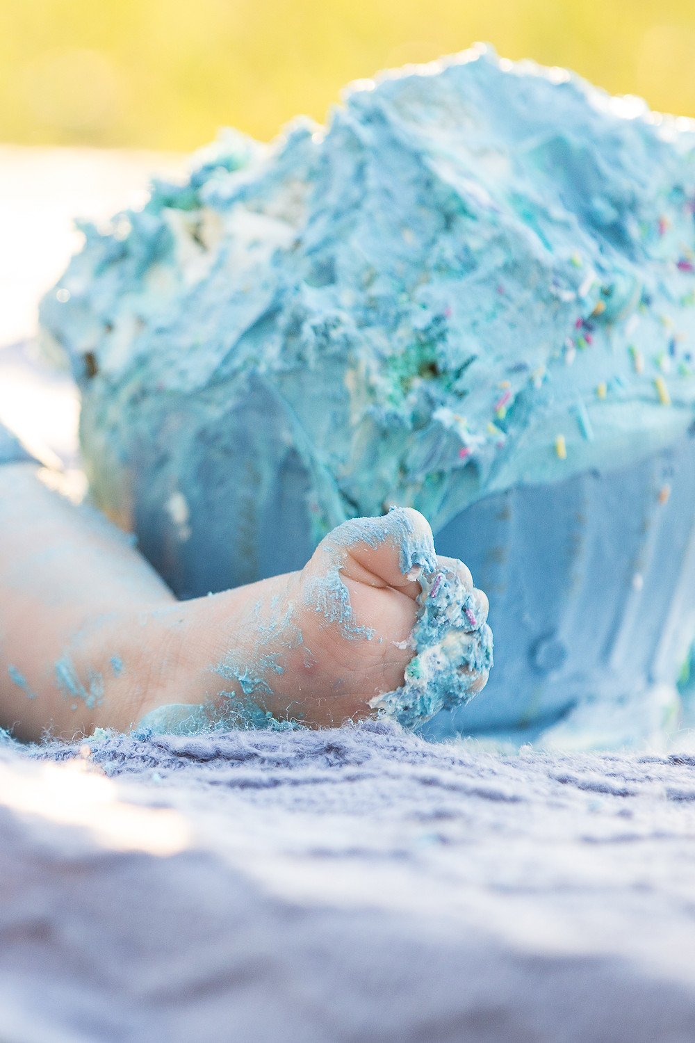 baby boy outdoor cake smash sydney foot covered in blue icing