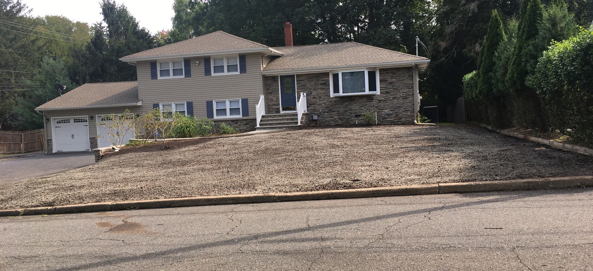 Existing lawn removed and property graded
