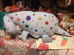stuffed polka-dot dinosaur