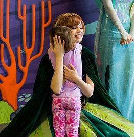 Portland Princess Parties. Children's Entertainment. Princesses in Hillsboro Beaverton Gresham Tigard Oregon City West Linn. Giving Child a Hug