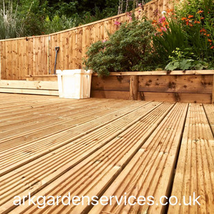 Decking, raised border, feather edge fencing, gate and steps