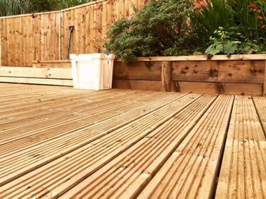 Decking, raised border, feather edge fencing, steps
