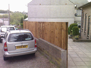 Feather edge fencing on a wall