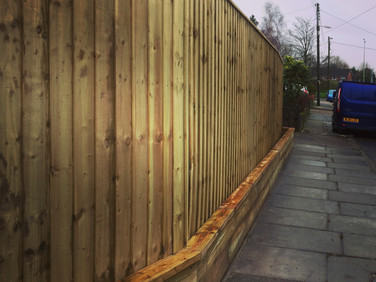 6ft Feather edge and Sleeper wall.