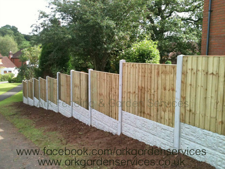 Feather edge panels with concrete posts and gravel boards