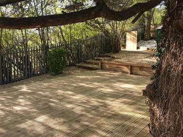 Decking, retaining oak wall, landscape stone
