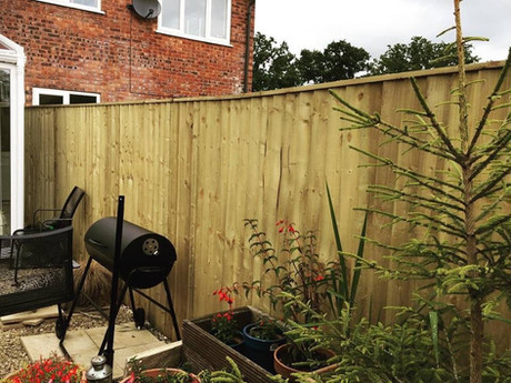 Feather edge garden fence with frame