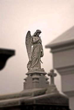 Cemetery Statuary, New Orleans, Louisiana.jpg