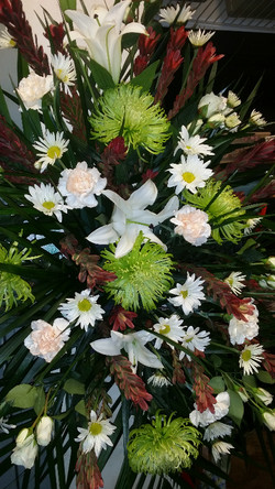 9) Lily, carnations and mums- $125+
