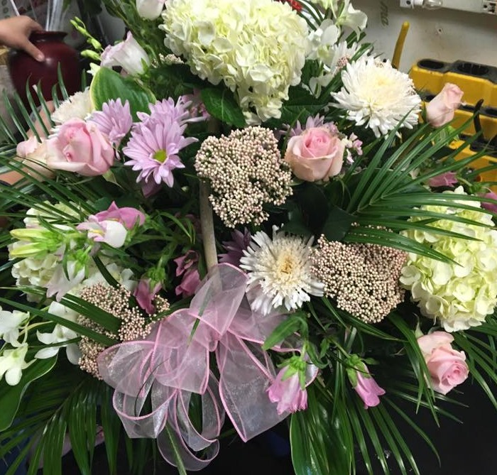soft pink funeral tribute basket
