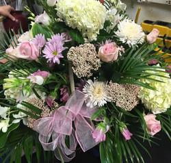 soft pink funeral tribute basket