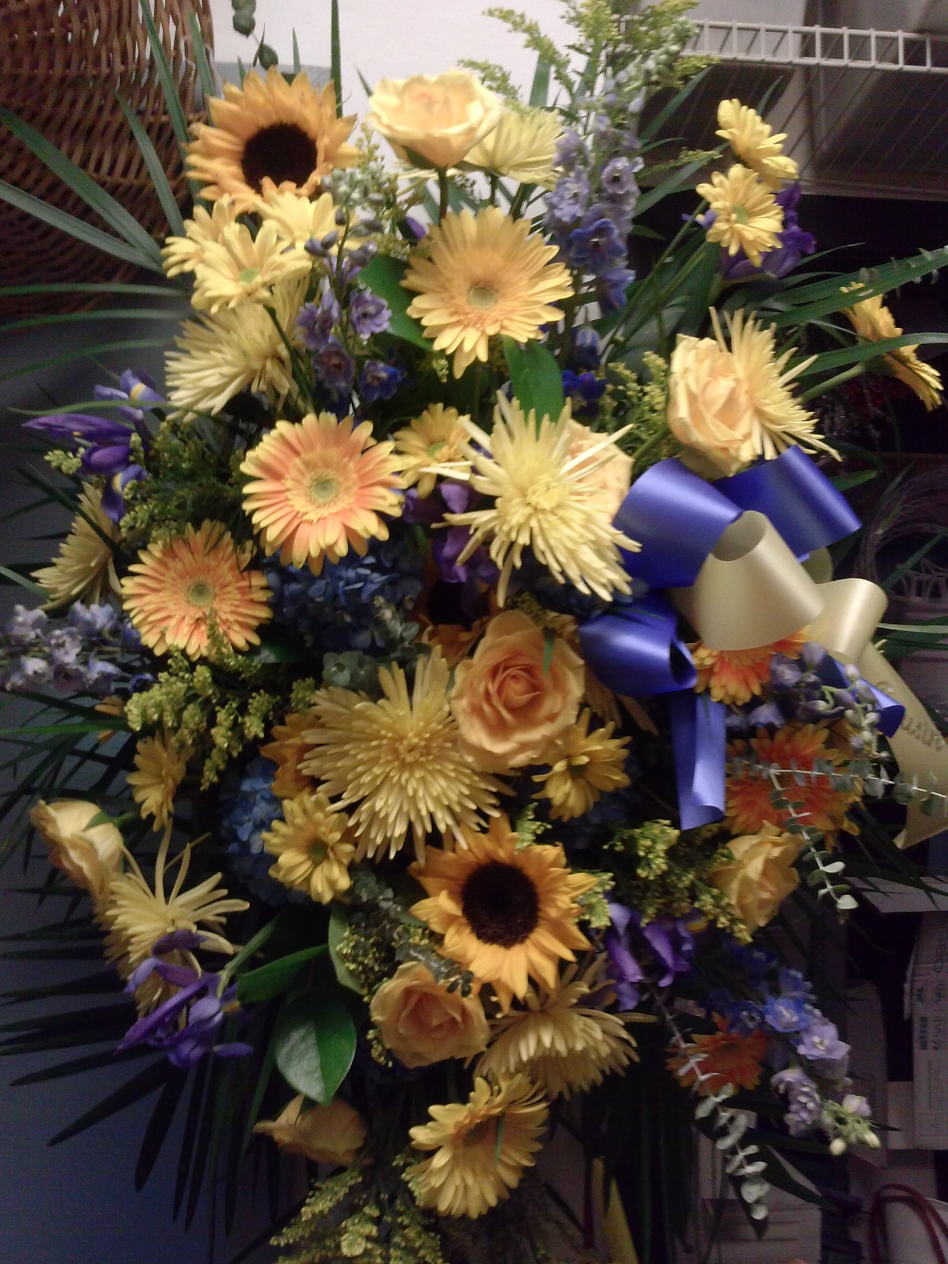 15) Gerbera, Mums, Sunflowers $150+