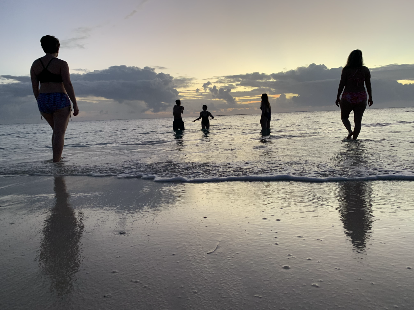 Rouge band of yogis take to the beach for a sunset swim