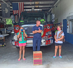 Girl Scouts Donate Cookies To Heroes And Organizations That Serve