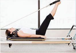 Woman doing exercise on pilates reformer