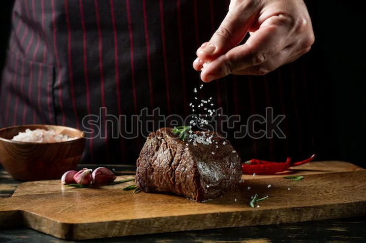 chef-hands-cooking-meat-steak-600w-14159