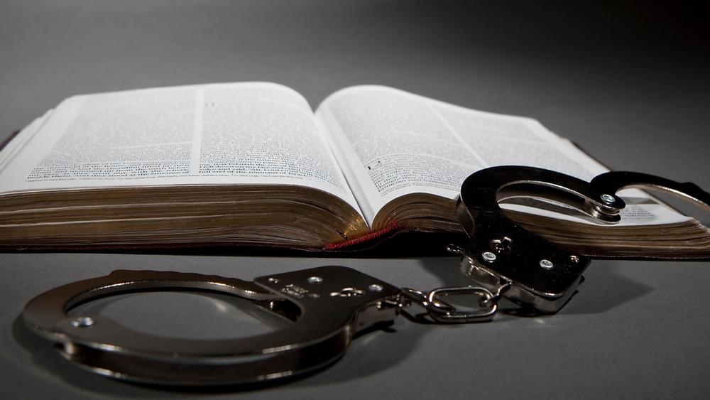 Bible & handcuffs