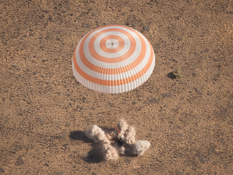 Russian space capsule returns to earth with two astronauts