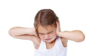Girl hand over her ears