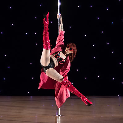 Pole dance reverse grab spin