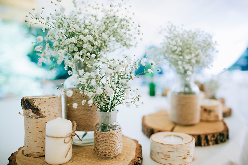 baby's breath, mason jars, wood slices