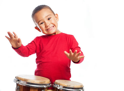portrait of a little boy playing bongos_