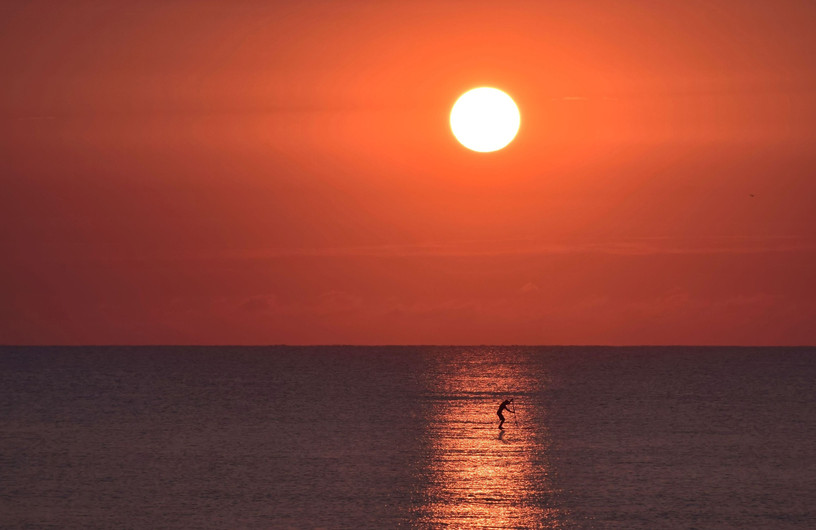 Paddleboarding at Dawn Horizontal crop 1