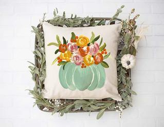 pumpkin blue floral pillow.jpg