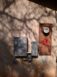 Example of a manual transfer switch, sub panel and inlet for proper generator set-up