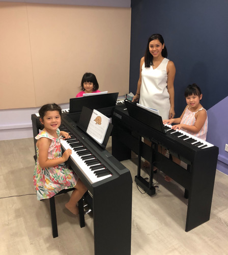 Little Pianists at piano_edited.jpg