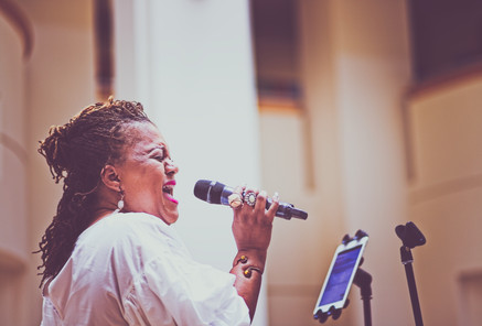 "Angelique of ""Angelique and Musical Explosions"" performing at a Juneteenth 2019 Celebration at Levine Museum of the New South"