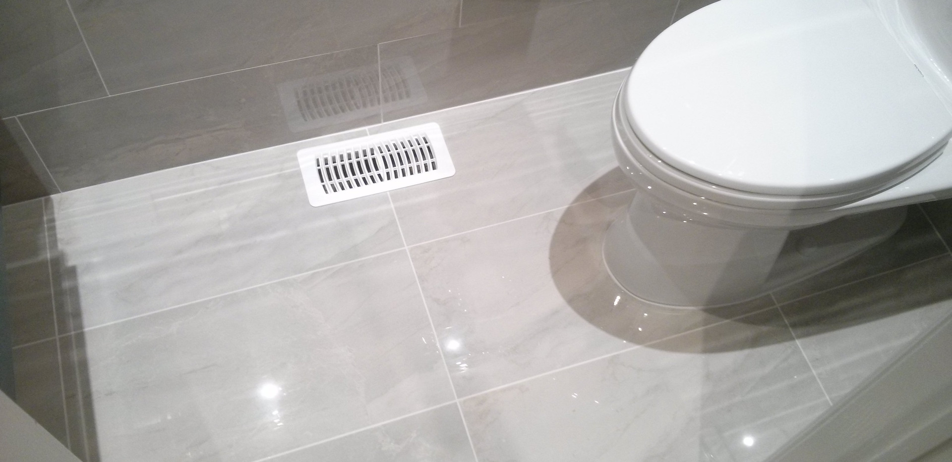 Powder Room with 12x24 Polished Tile