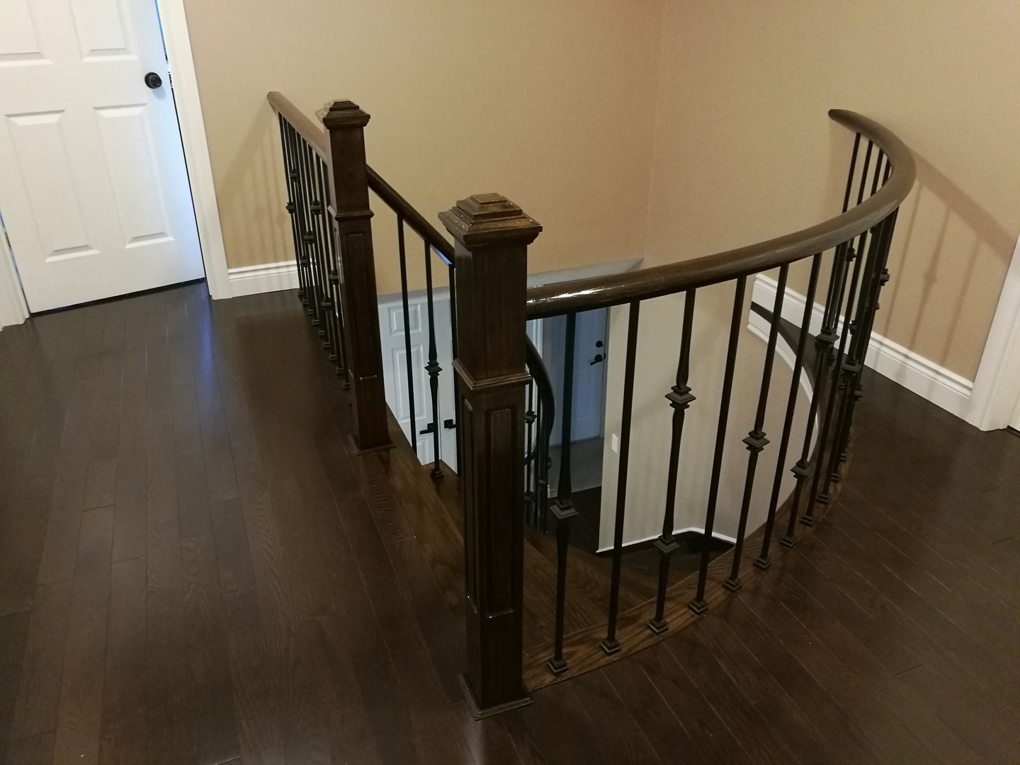 Upper Landing With Dark Hardwood