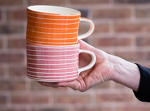 pink and oranage sgraffito wide mugs mus