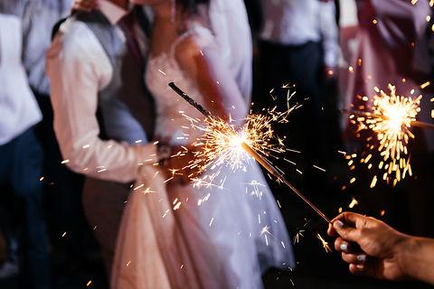 Sparkler in hands on a wedding - bride,