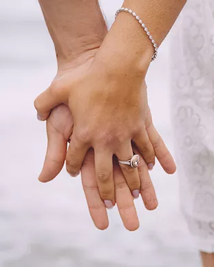 Engaged Couple Holding Hands.webp