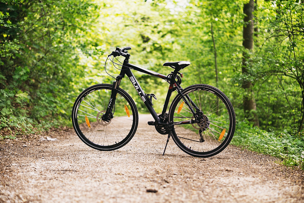 Black bike on a pathway in the forest
