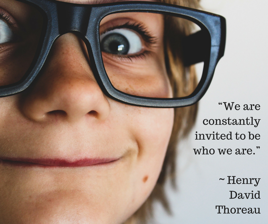 Close up image of a child's face, wearing thick black glasses, next to a quote from Henry David Thoreau saying 'we are constantly invited to be who we are.'