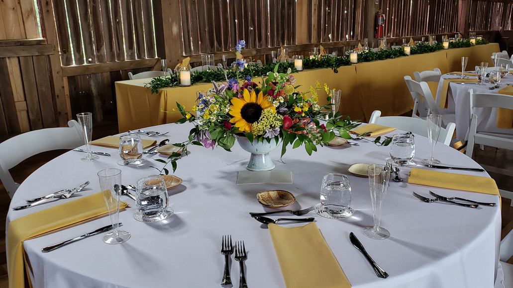 Beautiful table is set at a wedding in the historic Case Barlow Farm Barn in Hudson, OH