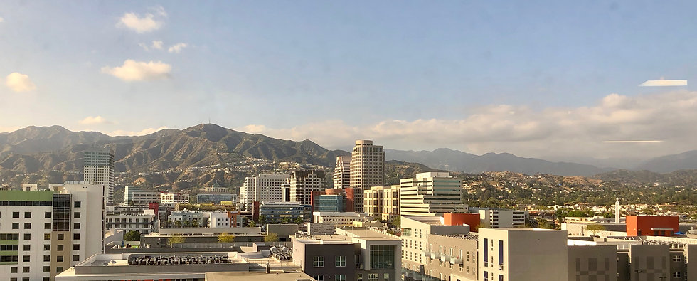 View from the office of downtown Glendale, CA skyline, buildings and mountains.