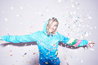 girl celebrating by throwing confetti