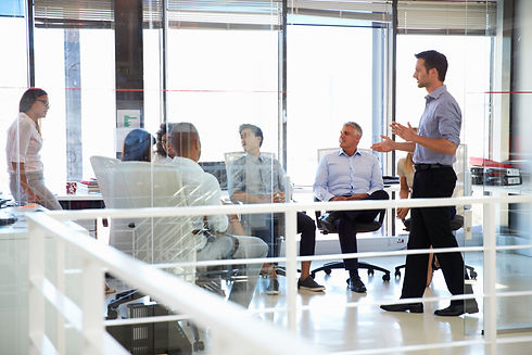 business-meeting-in-a-modern-office-PKMJ