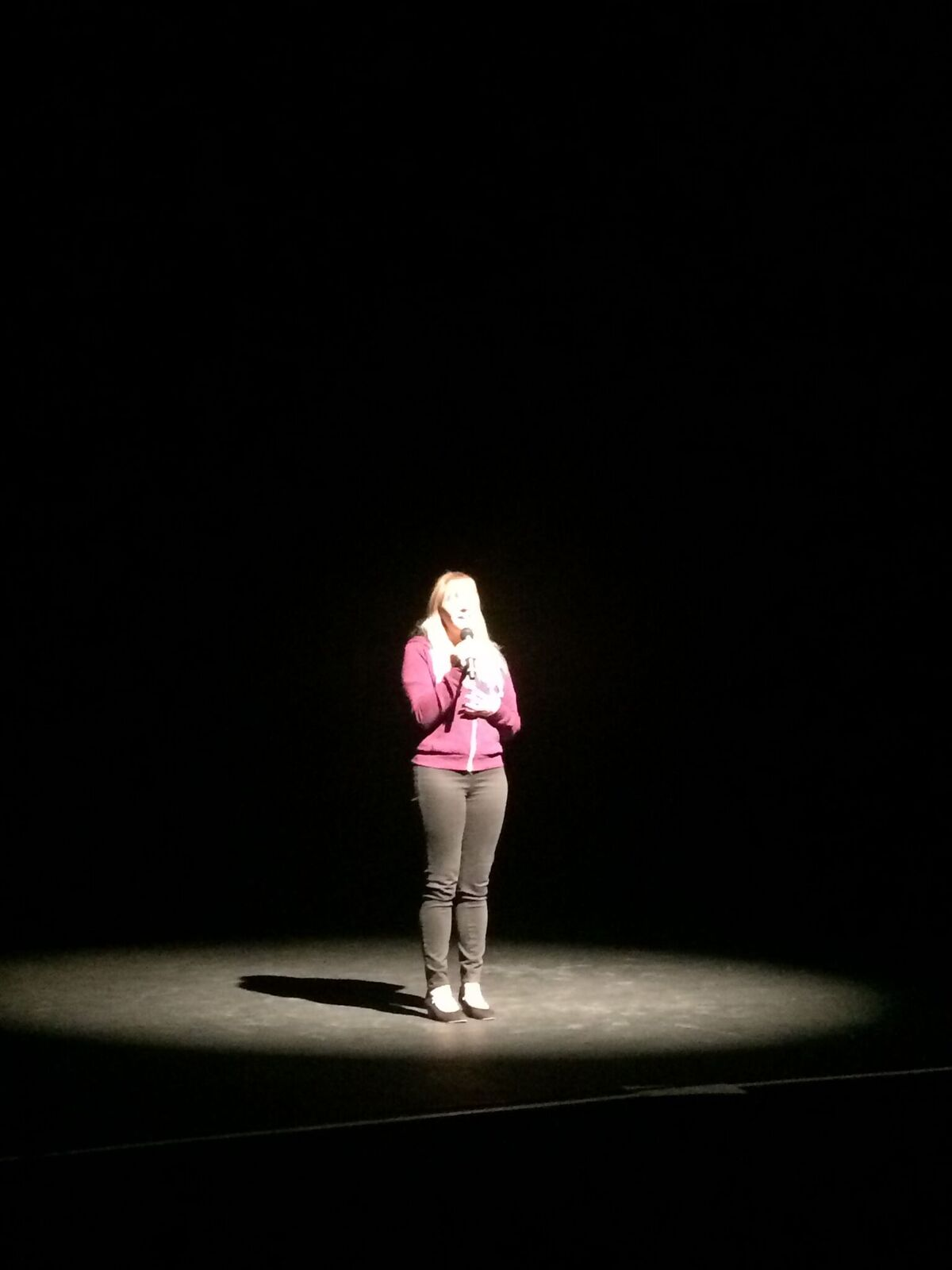 Christine singing in tech rehearsal
