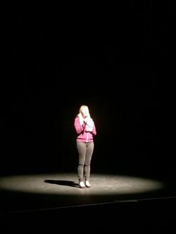 Christine singing in tech rehearsal