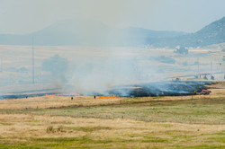 Fire fighters at a large grass fire