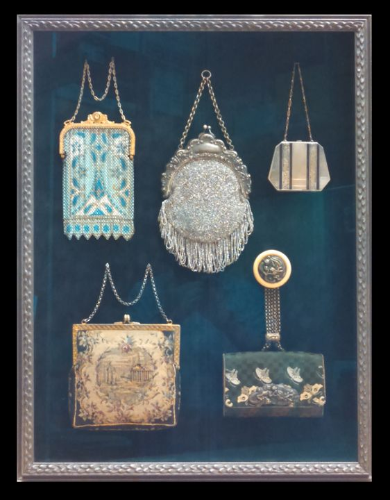 A collection of vintage hand bags framed