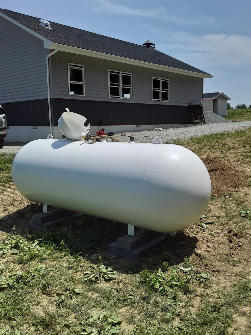 residential propane tank by building