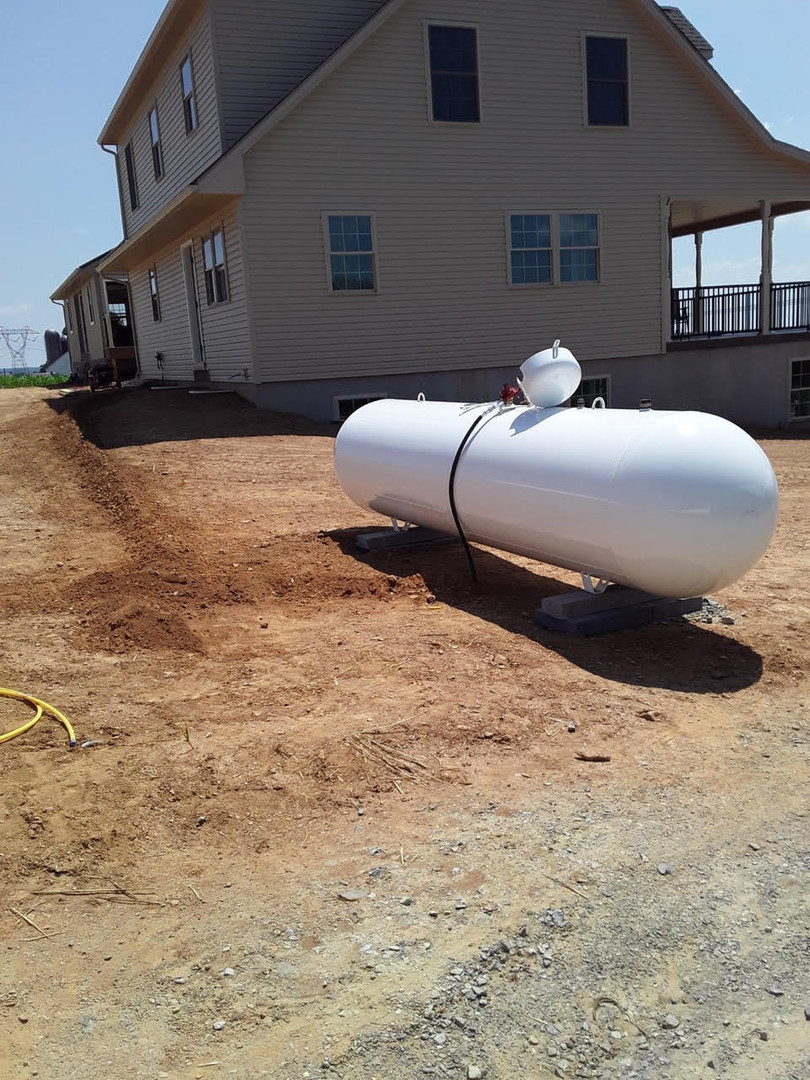 residential 500 gallon propane tank by house