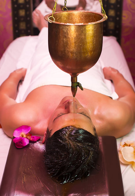 A shirodhara treatment, were a continuous stream of warm oil is poured on to the forehead. Good for stress and anxiety related to vata dosha.